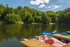 Paddle boats on a lake Royalty Free Stock Photo