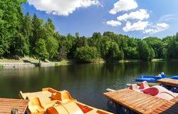 Paddle boats on a lake Stock Photo