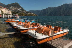 Paddle boats moored on lake Lugano Royalty Free Stock Photography
