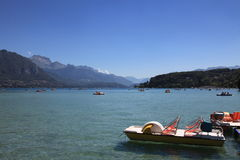 Paddle boats on mountain lake. Paddle boats on scenic mountain lake. Lake Annecy, France stock images