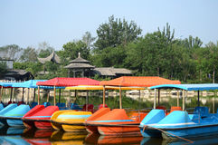 Paddle boats in park. Colourful paddle boats in park Royalty Free Stock Image