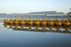 paddle boats and reflection Stock Photo