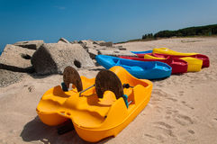 Paddle boats in the sand. On a beach in Italy Royalty Free Stock Photography