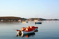 Paddle boats on sea stock photos
