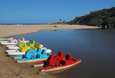Paddle boats on shore of lagoon at ramsgate. Kwazulu Natal Royalty Free Stock Photography