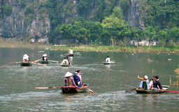 Paddle boats with tourists in Ninh Binh, Vietnam Royalty Free Stock Photo