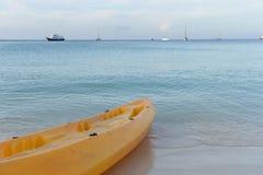 Paddle boats on white sandy beach Stock Photo