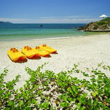 Paddle boats on white sandy beach Stock Photos
