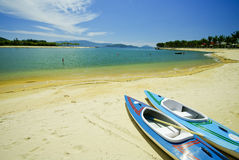 Paddle boats on white sandy beach and emerald sea Royalty Free Stock Image