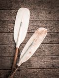 Paddle for canoe or kayak boat on wooden floor. Kayak boat for water sports activity stock photography