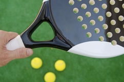 Paddle grip. Paddle tennis racket, hand and balls royalty free stock image