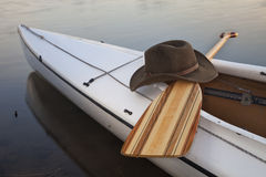 Paddle, hat and canoe Stock Image