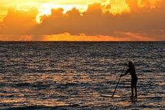 Paddle intern przy wschodem słońca obrazy stock