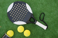 Paddle objects on turf Stock Photo
