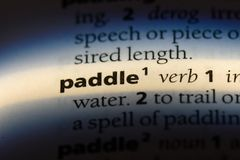 Paddle. Word in a dictionary.  concept royalty free stock image
