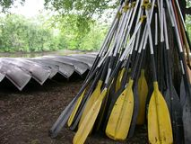 Paddle Pile. Taking a break from the river adventure Royalty Free Stock Image