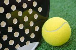 Paddle racket and ball. Closeup image of ball and paddle tennis racket stock photos