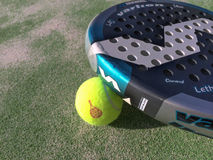 Paddle racket and ball. Paddle racket with yellow ball on an artificial floor Stock Photography