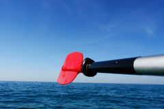 Paddle red in ocean Royalty Free Stock Photos