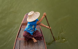 Paddle. Rowing is life in Thailand in the past. That requires a boat ride To travel in different places Stock Photo