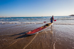 Paddle-Ski Fisherman Beach Stock Image