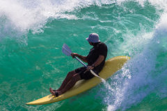 Paddle-Ski Rider Wave Dropping Stock Photo