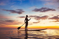 Paddle standing board, beach leisure activity, SUP stock photo