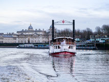 Paddle Steamer Elizabethan on the Thames at Greenw. Paddle Steamer Elizabethan of Thames Luxury Charters (TLC) steams toward viewer, with winter afternoon Royalty Free Stock Photo