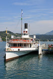 Paddle steamer at pier in Lucerne, Switzerland. royalty free stock photography