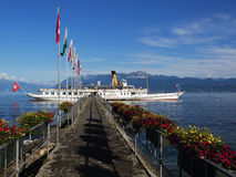 Steam Boat on Lake Geneva stopping at Quay Stock Images