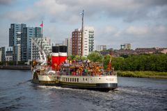 Paddle Steamer Waverley heading `doon the Watta`, Glasgow, Scotland. A view of the world famous Paddle Steamer Waverley heading down the River Clyde looking West Stock Photo