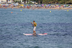 Paddle surf at the beach Stock Photography