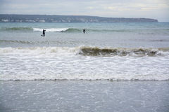 Paddle Surfers Large Waves Royalty Free Stock Images