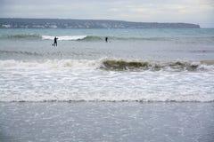 Paddle surfingowów ampuły fala Obrazy Royalty Free
