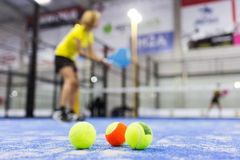 Paddle Tennis Balls On Blue Turf In Court. Stock Photos