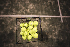 Paddle tennis basket. In court with balls Royalty Free Stock Photography