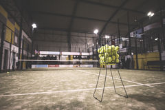 Paddle tennis basket. In court with balls Royalty Free Stock Photos