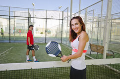 Paddle tennis couple in court Royalty Free Stock Photos