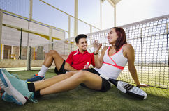 Paddle tennis couple drinking water Stock Image