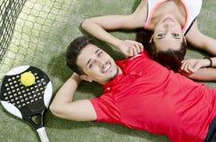 Paddle tennis couple resting Stock Photo