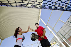 Paddle tennis couple team fair play Royalty Free Stock Photography