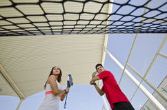 Paddle tennis couple in wide angle image Royalty Free Stock Photography