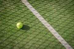 Paddle tennis court and net with a ball on the net shadow Royalty Free Stock Images