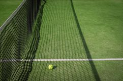 Paddle tennis court and net with a ball on the net shadow Stock Images