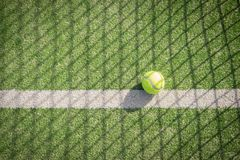 Paddle tennis court and net with a ball on the net shadow Royalty Free Stock Photography