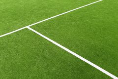 Paddle tennis green grass camp field texture. Paddle tennis green grass field texture white lines Royalty Free Stock Photos