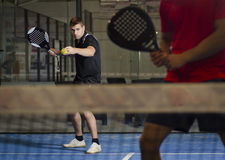 Paddle tennis match. Paddle tennis couple ready for serve indoor Stock Photo