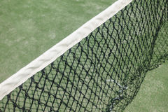 Paddle or tennis net in the court. Green ground Stock Photo