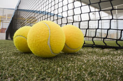 Paddle tennis objects. On turf with net background royalty free stock photo