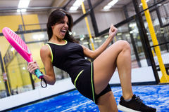 Paddle tennis player celebrating a win. Royalty Free Stock Image